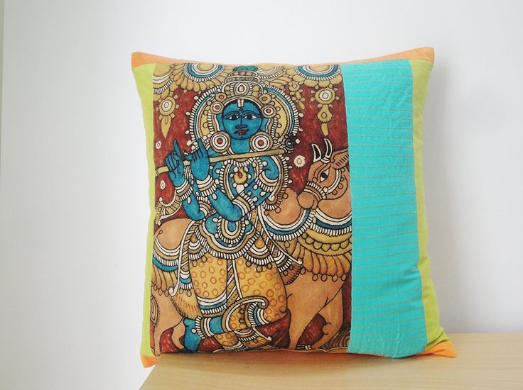 Hand painted Kalamkari panel has been patched with vibrant colours in this beautiful cushion cover.  The Srikalahasti style of Kalamkari, wherein the kalam or pen is used for free hand drawing of the subject and filling in the colours, is entirely hand worked. This style flowered around temples in Andhra Pradesh, India and so had an almost religious identity - scrolls, temple hangings, chariot banners and the like, depicted deities and scenes taken from the great Hindu epics - Ramayana…