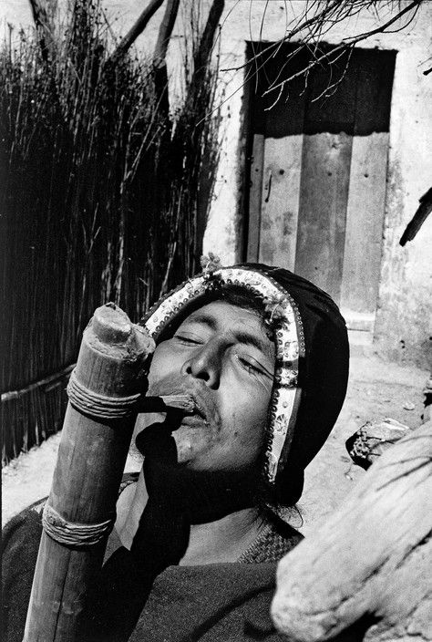 Sergio Larrain BOLIVIA. Tarabuco. Indian playing the Tocoro, typical instrument of the region. 1958.
