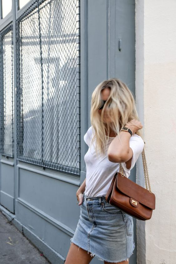 Street style   Ultra casual white t-shirt, denim skirt and a purse