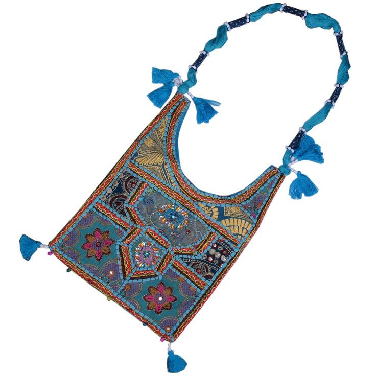 This ethnic and stylish aqua blue shoulder sling bag can enhance your feminity. This alluring bag is decorated with mirror and patch work in luscious colours stitched with threads. The patches are detailed with handmade embroidery by hard working women of Rajasthan. There is a aqua blue shoulder sling which is graced with same colour tassels and border.  Vist for Buy this Stylish Blue Sling bag:- http://khoobsurati.com/khoobsurati/aqua-blue-mirror-embroidery-work-shoulder-bag-120-khoobsurati