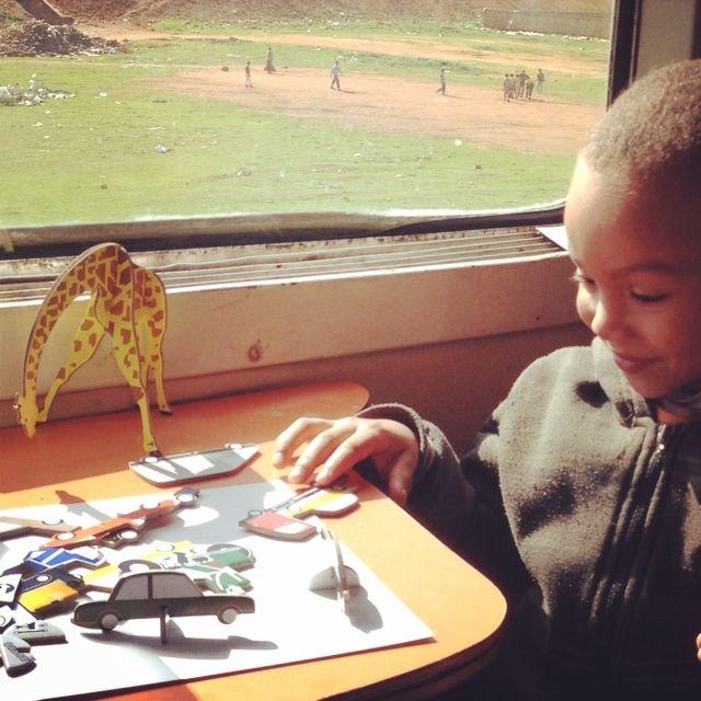 Boy in train with Teknika Traffic, Morocco