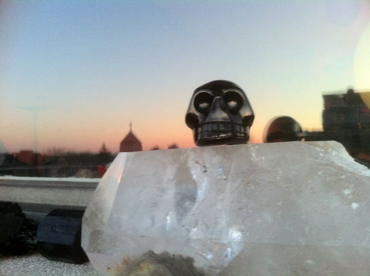 Jet skull on quartz with Montreal evening sky reflection