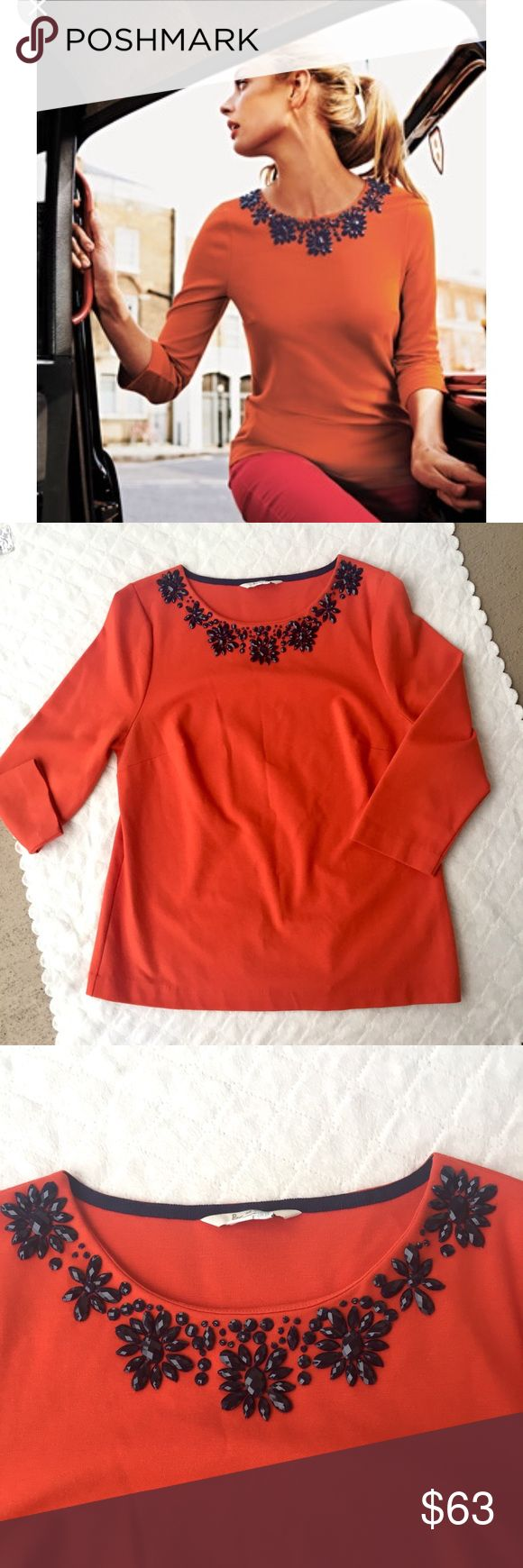 "10 / Boden orange embellished ponte top Orange long sleeve top w/ beautiful embellishments at the neckline. 🌟 32% cotton + 31% modal + 28% polyamide + 9% elastane. 3/4 length sleeves. Semi-fitted shape.   SIZE: 10 waist: 18.5"" sleeve length: 19"" length: 24.5""  ❌ no trades ✔️offers welcome! ❣️add to bundle for private offer! Boden Tops"
