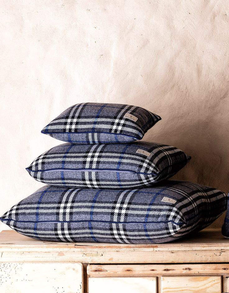 Ambassador Wool Pillow case is crafted in a plaid and finished with navy blue trims. It comes with a fluffy and springy pillow insert.