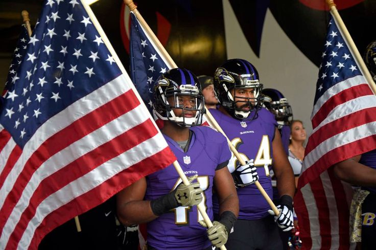 Steelers vs. Ravens:  21-14, Ravens  -  November 6, 2016  -   Baltimore Ravens cornerback Anthony Levine (41) and offensive guard John Urschel (64) wait to run onto the field with United States flags  before an NFL football game against the Pittsburgh Steelers, Sunday, Nov. 6, 2016, in Baltimore. (Credit: AP / Nick Wass)