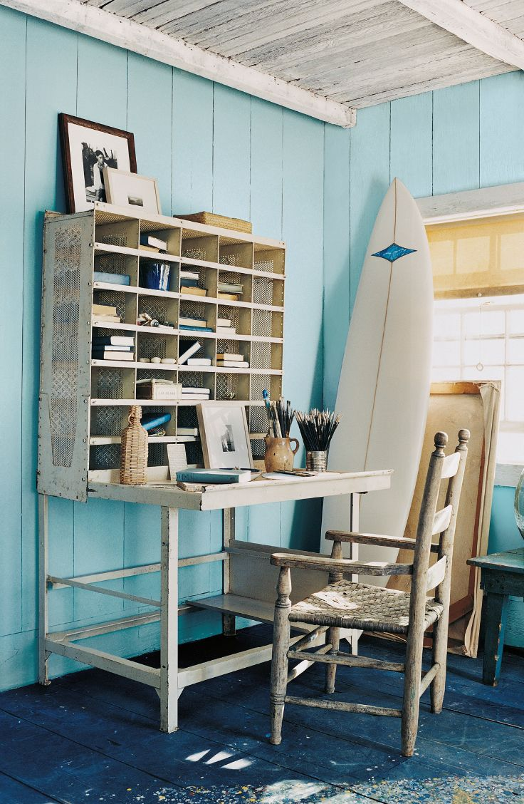 Surfshop chic inspires a home office, with with blue walls and white trim and ceiling from Ralph Lauren Paint.