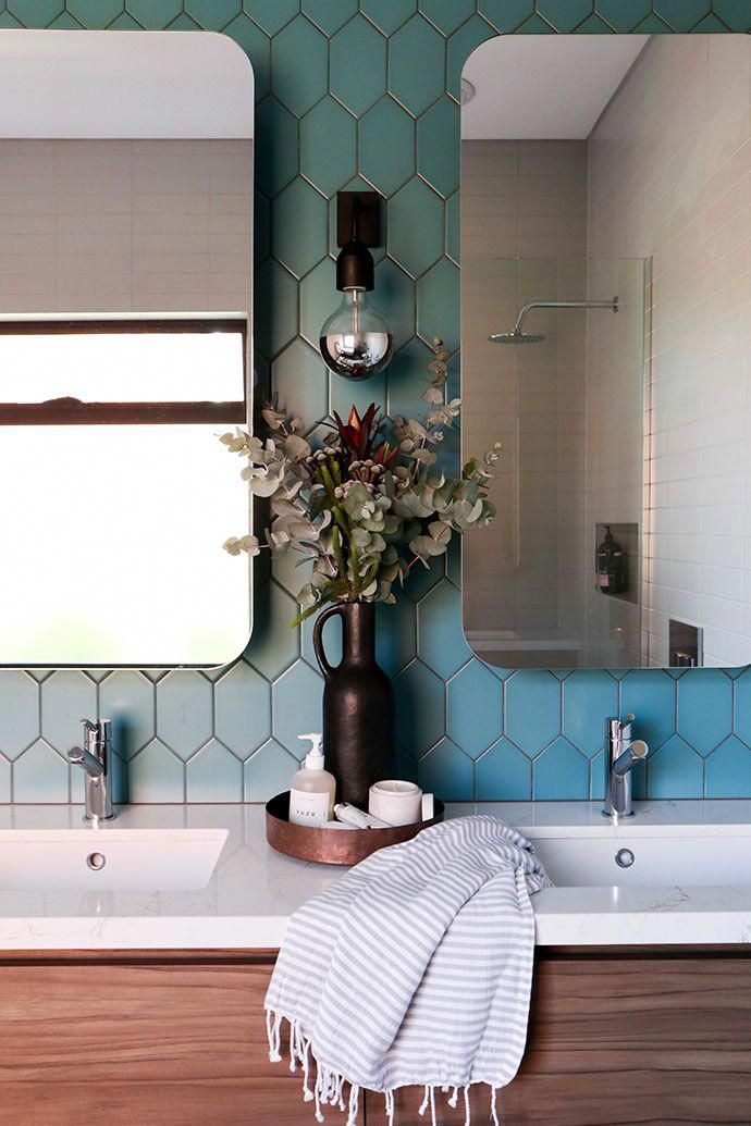 Here Teal Tiles Oblong Mirrors And A Double Vanity Unit Combine To Create A Wonderfully Modern And Styli Teal Bathroom Accessories Zen Bathroom Teal Bathroom