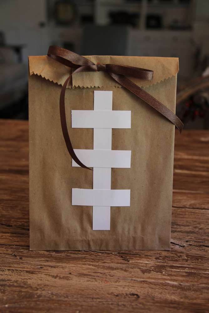 Football party paper bag favors! See more party planning ideas at CatchMyParty.com!