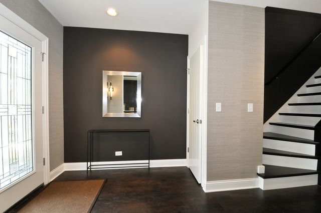 love the dark hardwood floor matching stairs grey walls