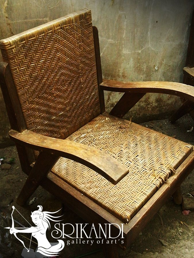 old chair with a unique design, this chair is much preferred because of its unique design. made of teak wood, this chair can last for a long time