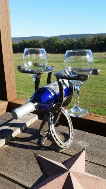 Horseshoe wine rack my husband made from reclaimed shoes. To order, call the store at 717-474-8472. Www.stockyardstyle.com