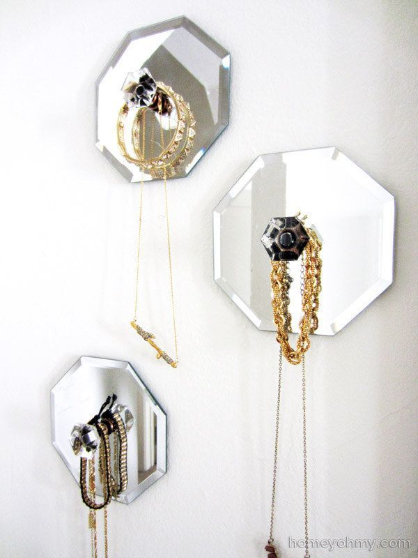 Combine dollar store mirrors and cute knobs to make your own decorative necklace hangers.