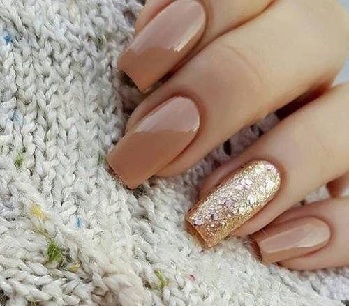 Nude and glitter nail art