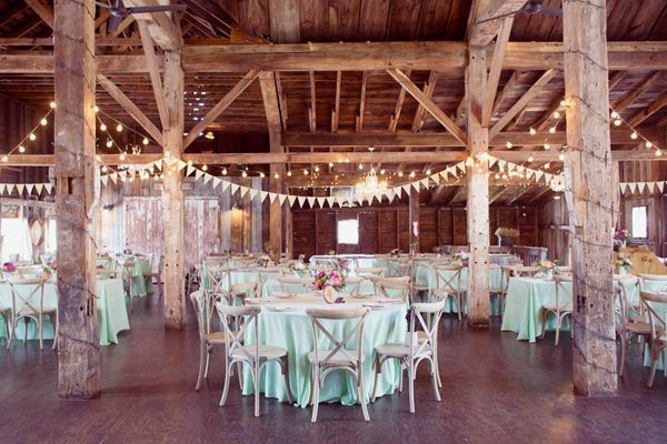 barn wedding receptions - photo by Dreamlove Photography http://ruffledblog.com/bishop-farm-wedding