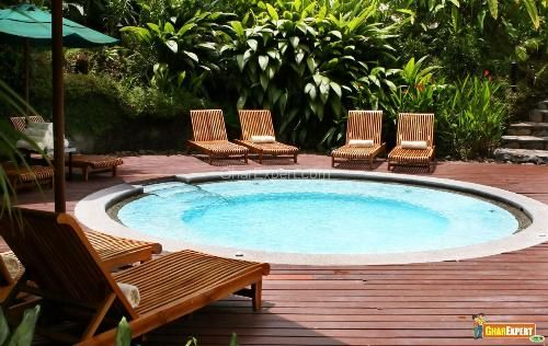 Small round inground pool designs with deck and outdoor furniture with umbrella