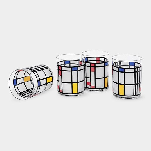 The Mondrian Tumbler is ideal for serving a variety of beverages. The vivid geometric patterns on the double old-fashioned glass tumbler are based on the painting, Composition in Red, Blue, and Yellow (1937-42), by renowned Dutch artist Piet Mondrian. Mondrian's paintings are known for the complexity that contradicts their simplicity. He is best known for non-representational paintings consisting of rectangular forms in red, yellow, blue, or black, separated by thick black lines.