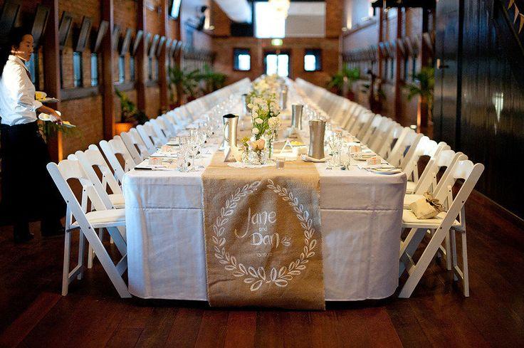 Photography: Sugarblush Photography - sugarblush.com.au Read More: http://www.stylemepretty.com/australia-weddings/queensland-au/brisbane/2013/01/11/brisbane-racing-club-wedding-from-sugarblush-photography/ Long banquet wedding table with hessian runner