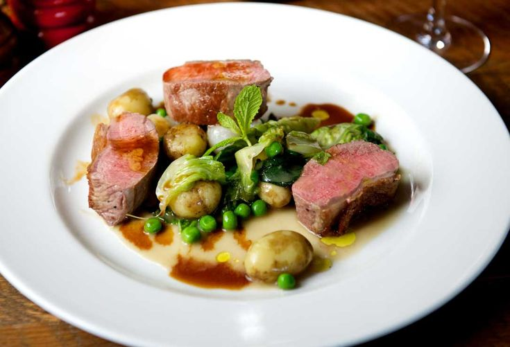 Aged rare breed ribeye steak, peas, potato, Brussels sprouts, Dianne sauce.