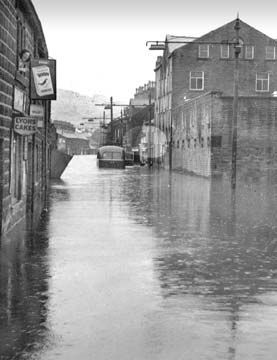 A thoroughly water-logged Mytholmroyd in 1954, when flash floods suddenly struck in August.