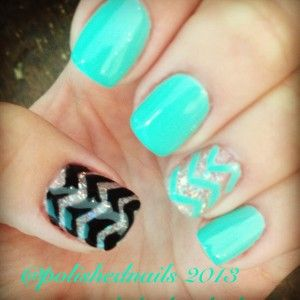 Clean and chic chervron nail art handpaited aqua and black with glitter accent