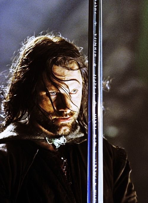 Aragorn with Anduril, Flame of the West, reforged from the Shards of Narsil