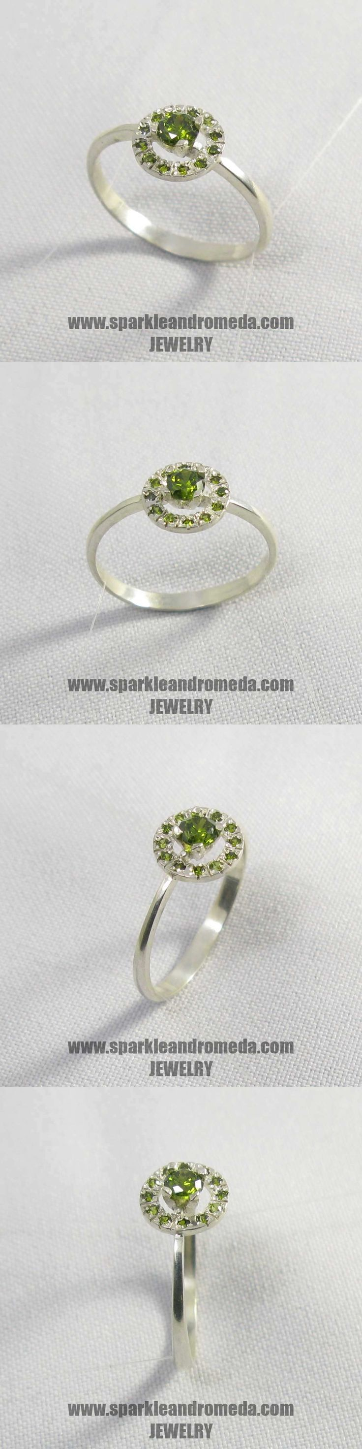 Sterling 925 silver ring with 1 round 4 mm and 12 round 1,25 mm green peridot color cubic zirconia gemstones.