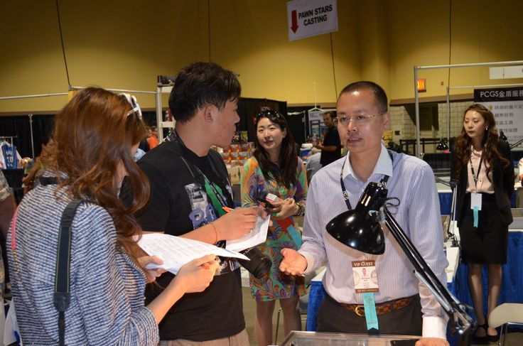 Reporters Keyang Pang of Sing Tao Newspapers and Caesar-Zi Yuan Gao of the World Journal/Chinese Daily News interviewed Chen HaoMin, General Manager of the PCGS Guangzhou, China Submission Centre during the June 5 - 7, 2014 Long Beach Coin, Currency, Stamp & Sports Collectible Expo. #LBExpo #LongBeachExpo #LongBeach #Coin #Currency #Stamp #Sportscard #ChineseDailyNews #SingTao #Newspapers #Interview #ChenHaoMin #PCGS #Chinese #Antiques #Numismatics