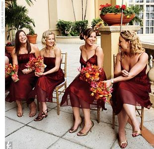 Each of Heather's stylish maids chose her own gown in a custom-created color that complemented everyone's skin tone: salmon charmeuse with a burgundy chiffon overlay. The dresses by Thread Bridesmaid added a pop of color to the ceremony and were a preview of the explosion of color to come at the reception. Their bouquets were made of tulips, gloriosa lilies, ranunculuses, calla lilies, and Mokara orchids.