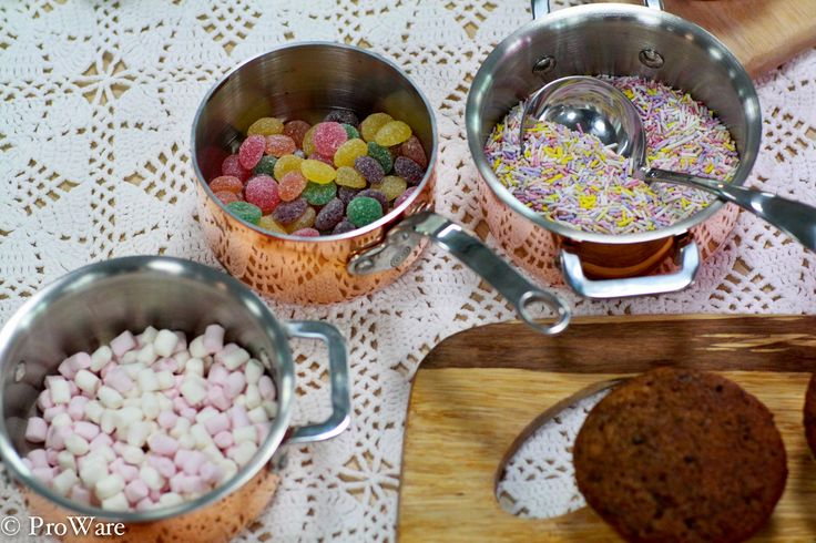 Mini casseroles and mini pans holding some of the decoration goodies.
