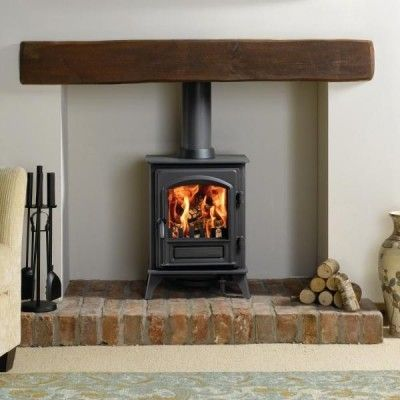 http://www.gr8fires.co.uk/stovax-riva-plus-small?utm_source=Social&utm_medium=Social Stovax Riva Plus Small #woodburner on a brick hearth with whitewashed walls and a wooden mantle. #homedecor