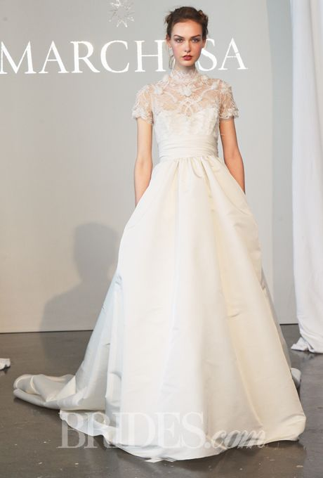 Brides.com: . Trend: Collars. Chantilly lace ball gown wedding dress with a silk faille skirt, embroidered high-neck bodice, and short sleeves, Marchesa