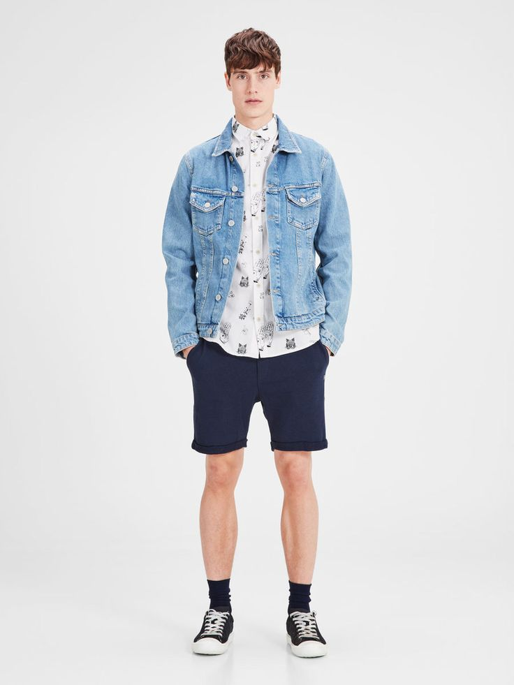 Men's outfit: white slim fit short sleeved shirt with black print, oversized denim jacket, navy blue shorts, black and whtie sneaks | JACK & JONES