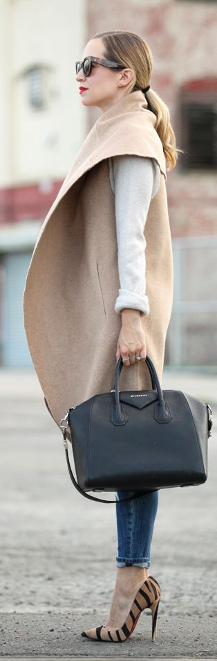 Fall / Winter - street chic style - white long sleeve t-shirt + camel sleeveless cape coat + denim skinnies + black handbag + leopard print stilettos + sunglasses + red lips:
