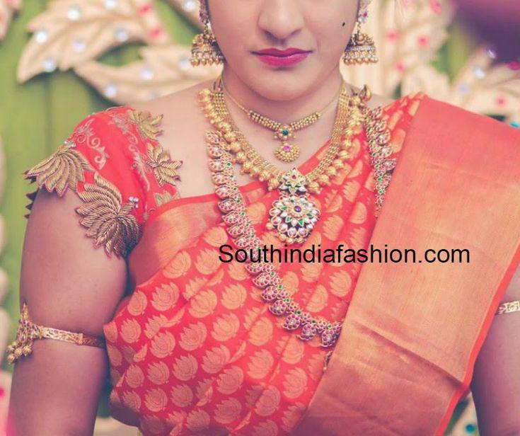 Beautiful lotus design blouse for pattu sarees embellished with stones and zardosi work. Related PostsTarun Tahiliani Designer BlouseThread Work Designer BlouseElbow Length Sleeves Pattu Saree Blouse DesignsStylish Embroidered Blouse