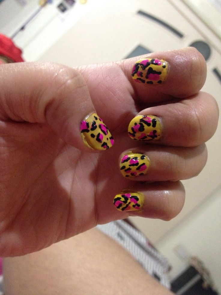 Yellow n pink cheetah print nail art...