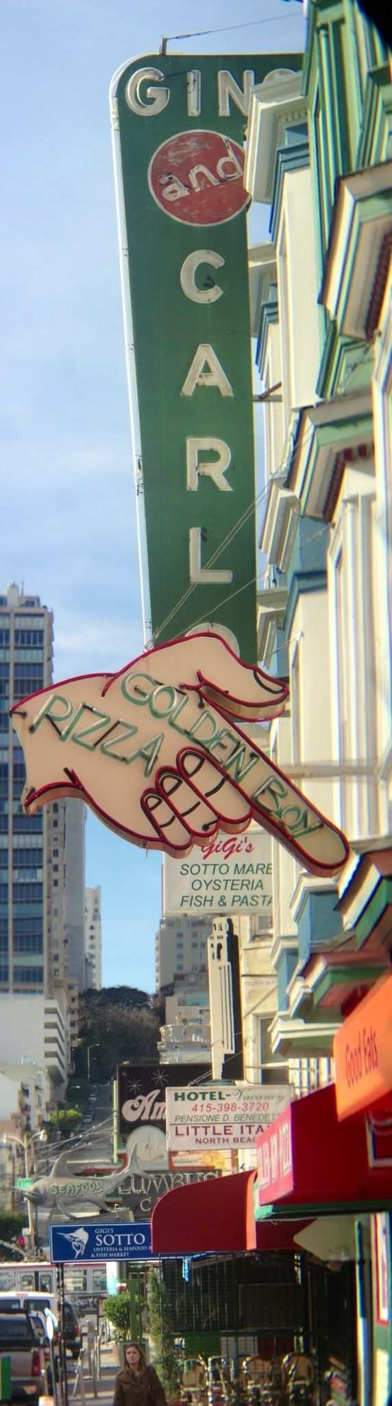 Golden Boy Pizza, North Beach, San Francisco. Get the garlic clam or combo pizza.