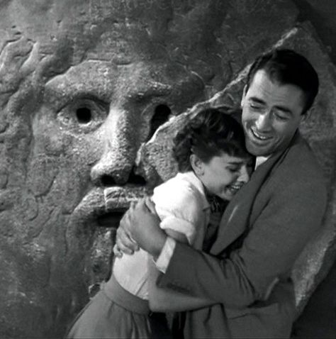 Roman Holiday with Gregory Peck Apparently it was Peck's idea to fake the missing hand for this scene. Unaware, her reaction was genuine.