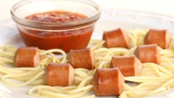 Hot dogs with spaghetti noodles cooked through them to look like spiders. Your kids will love them!