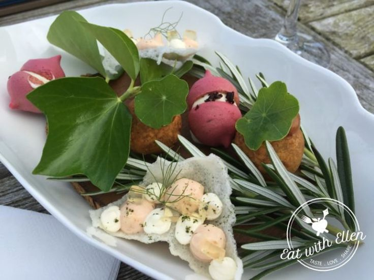 The gorgeous pink creation is a beetroot meringue with cream cheese, a donut with spicy lamb, and a rice cracker with smoked salmon mousse at the Driftwood Hotel, Portscatho.
