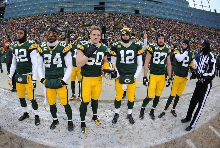 2013 Playoff Team captains. Morgan Burnett, Jarrett Bush, AJ Hawk, Aaron Rodgers, Jordy Nelson and Mason Crosby.