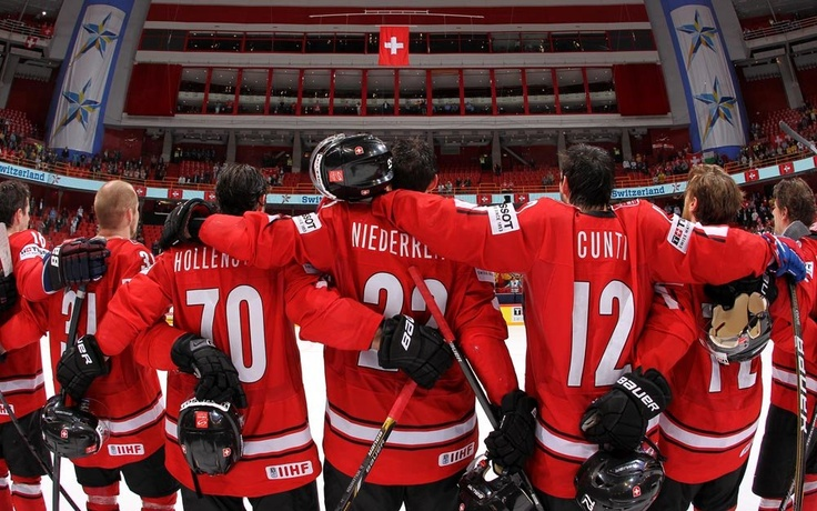 Switzerland players look on during the national anthem after a 3-0 semifinal round win over the U.S. at the 2013 IIHF Ice Hockey World