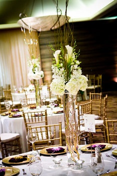 tall centerpiece curly willow branches in water, white hydrangea, white calla lilly & orchids""
