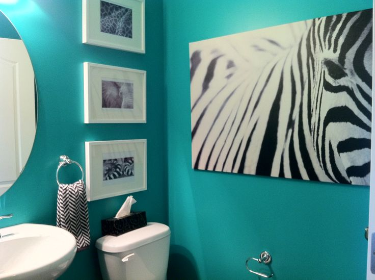 Teal powder room. It all started with the big Ikea zebra print. Ended with a teal and African animal theme
