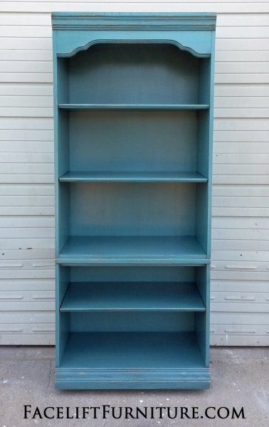 "Large Cabinet re-purposed into Bookshelf. In distressed Sea Blue with Black Glaze. Second and fourth shelves adjustable. A great option for both books and decorative display. 76"" tall, 32"" wide, 19.5"" deep. on Facelift Furniture  http://www.faceliftfurniture.com/wp-content/gallery/finished-pieces/cab-bookshelf-lg-after01.jpg"