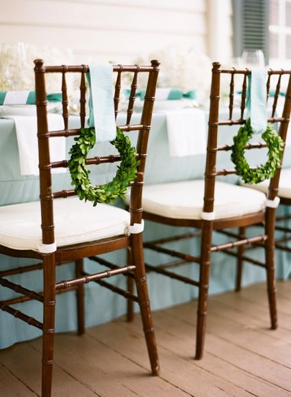 mini wreaths on backs of chairs
