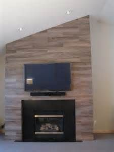 fireplace with wood tile at DuckDuckGo