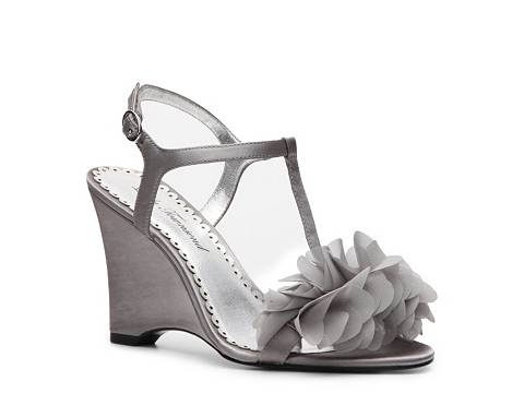 $49.95 @ DSW comes in wide and half sizes. Lulu Townsend Valencia Wedge Sandal.
