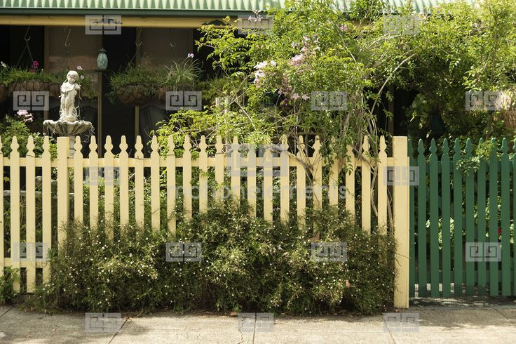 Yellow Picket Fence And Gate House Stock Footage | Royalty-Free Stock Photo Library | 10336230