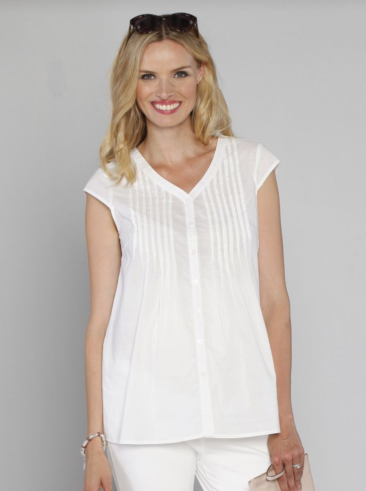 Button Front Loose Fit Nursing Top in White, $49.95, is a versatile shirt that will see you right through from conception to breastfeeding.
