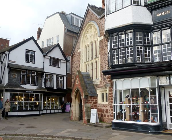 Exeter, medieval buildings opposite the cathedral. Just round the corner on the right ~ roman wall.